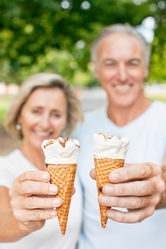 Senior Couple Holding Ice Cream Cones