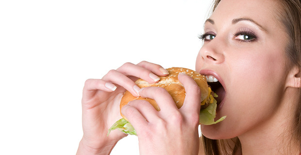 bigstock_Girl_Eating_Burger_4655356