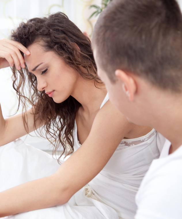 unhappy  couple in bedroom under stress