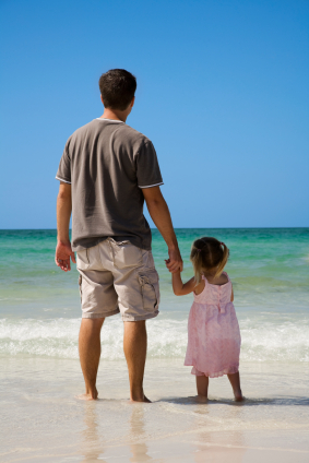 Dad and little girl on beach.jpg